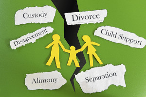 Paper cutout family with divorce related messages